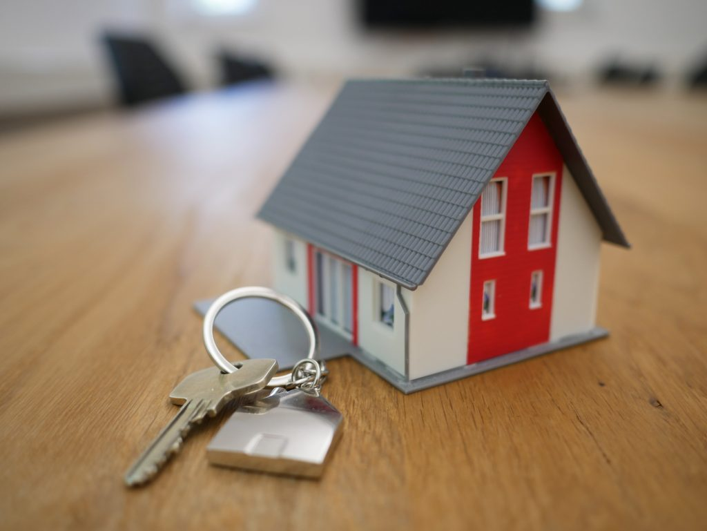White, grey and red house used to symbolize how your credit score affects buying a home.